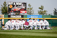 Members of the Missouri State Baseball team take a knee and pray prior to a game against the Wichita State Shockers on April 9, 2011 at Hammons Field in Springfield, Missouri.  Photo By David Welker/Four Seam Images