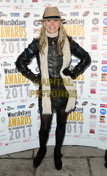CARLEY STENSON .At the Whatsonstage.com Awards Concert Launch Party, Cafe De Paris, London, England, UK, .3rd December 2010..full length black leather jacket skirt tights hands on hips beige hat scarf gloves fedora.CAP/CAN.©Can Nguyen/Capital Pictures.