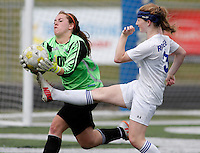 NWA Democrat-Gazette/DAVID GOTTSCHALK - 5/8/15 - Rogers Heritage High School goalie Stormy Concoby grabs a ball in front of Rogers High School Lady Mounties Skylurr (cq) Patrick during the first half of play Friday May 8, 2015 at Rogers High Smith Stadium.
