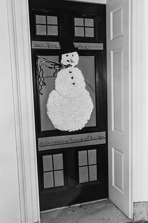 Decorated snowman on door at Congressional's office around Christmas. (Photo by Dev O'Neill/CQ Roll Call via Getty Images)