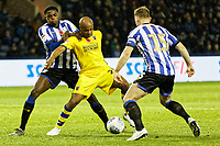 Andre Ayew of Swansea City (C) against Tom Lees of Sheffield Wednesday (R) during the Sky Bet Championship match between Sheffield Wednesday and Swansea City at Hillsborough Stadium, Sheffield, England, UK. Saturday 09 November 2019