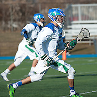 Alexander Gomes,'15, charges down the field as the Salve Regina Men's Lacrosse team battles Anna Maria at Gaudet Field.