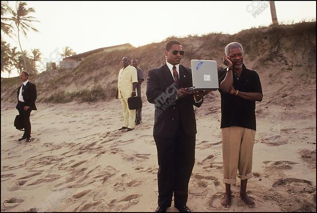 Kofi Annan, UN Secretary General, talking on a satellite phone. &amp;#xD;Prampram Beach, Accra, Ghana, July 2000&amp;#xD;<br />