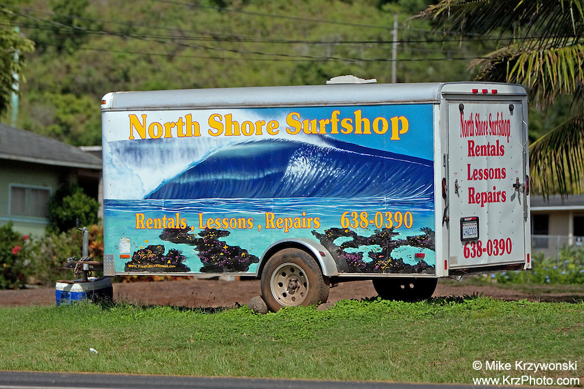 North Shore Surf Shop advertisement sign on trailer near Shark's Cove, North Shore, Oahu, Hawaii