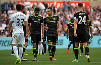 John Terry of Chelsea speaks to team mate Diego Costa before a corner kcik is taken during the Premier League match between Swansea City and Chelsea at The Liberty Stadium on September 11, 2016 in Swansea, Wales.