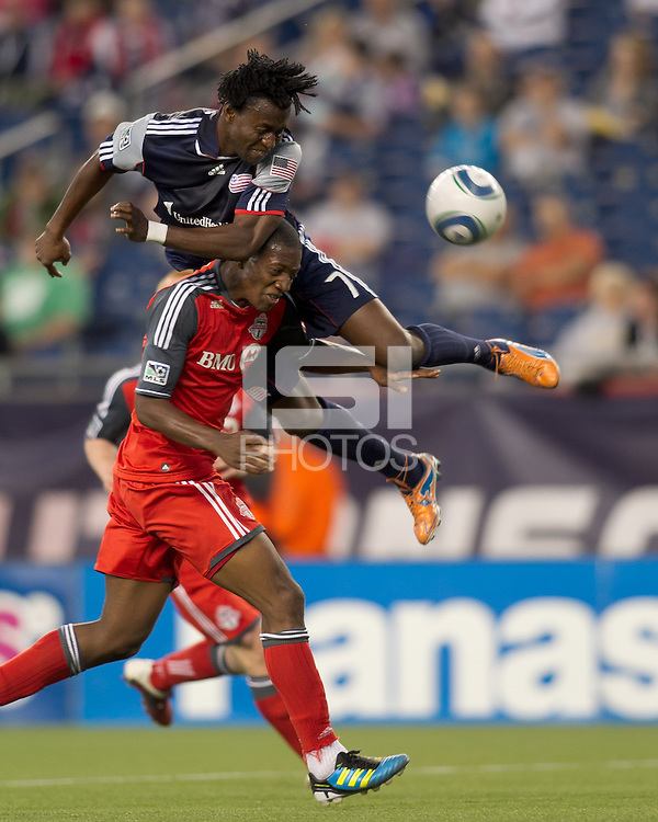 New England Revolution forward Kenny Mansally (7) heads the ball as Toronto FC defender Doneil Henry (4) defends. In a Major League Soccer (MLS) match, the New England Revolution tied Toronto FC, 0-0, at Gillette Stadium on June 15, 2011.