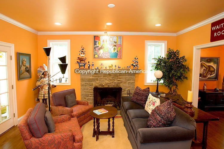 WOODBURY, CT--29 JUNE 2007--062907JS11-The Woodbury home of Elaine Ryan, author of the book &quot;Color Your Life: How to Design Your Home with Colors from Your Heart&quot;, is filled with color. The family room is painted in cantaloupe. <br /> Jim Shannon/Republican-American