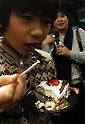 December 24, 2016, Tokyo, Japan - A boy eats a piece of a Christmas cake decorated with insects such as cicades and mealworms at a Christmas party to eat insect foods in Tokyo on Saturday, December 24, 2016. Some 30 people gathered to eat insect foods on the Christmas Eve as UN FAO reported that eating insects could help boost nutrition and reduce pollution.  (Photo by Yoshio Tsunoda/AFLO) LWX -ytd-