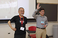 New York, NY, USA - June 24-25, 2017: OrigamiUSA 2017 Convention at St. John's University, Queens, New York, USA. The Challenge: Judy Hall, Florida, has never used a folding diagram in a class to fold the model. Judy got help from Makoto Yamagucki and Jason Ku. But with dedicated help, Judy learned to fold Yamaguchi's Cat.