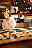USA, Colorado, Aspen, a chef prepares fish for the dinner crowd at Matsuhisa Restaurant on Main Street