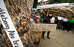 """A band of locals masquerading as illegal loggers and charcoal manufacturers made some of the more exuberant displays at Dayurejo's conservation carnival. Sign reads: """"if I'm finished, there can be floods and landslides"""""""