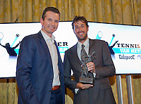 December 08, 2014, Amsterdam, Amstel Hotel, Tennis player off the Year Awards, Robin Haase receives  the Richard Krajicek trophy out of the hands of Richard Krajicek.<br />