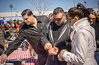 Foodies from around the city with their lobster rolls on opening day at the premiere outdoor food court, Smorgasburg in East River State Park in the Williamsburg neighborhood of Brooklyn in New York on Saturday, April 4, 2015. The marketplace features prepared and artisanal foods made in Brooklyn by small entrepreneurs. The market has provided a venue for numerous chefs and cooks to sell their wares, some of whom have grown into large successful businesses. (© Richard B. Levine)