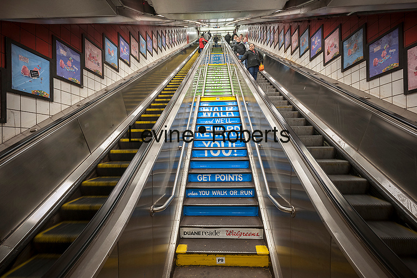 Stairs, surrounded by escalators show advertising for the Duane Reade chain of drugstores in the Fifth Avenue station in the subway in New York on Monday, April 22, 2013. The MTA is always looking for clever places to insert ads and to raise revenue. (© Richard B. Levine)