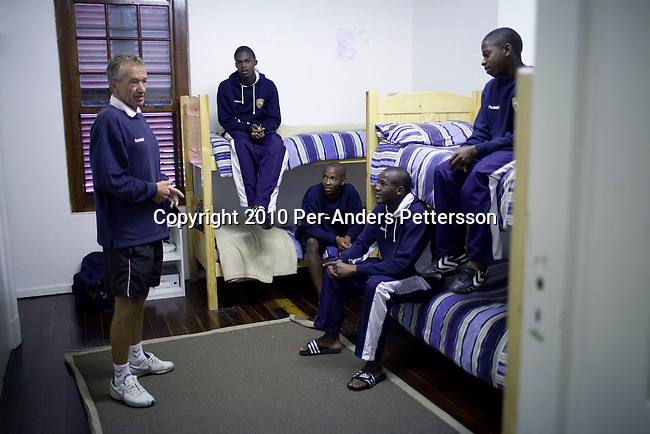 CAPE TOWN, SOUTH AFRICA - APRIL 9: Roald Poulsen, a Danish soccer coach, talks to young players in their residence after a training session on April 9, 2010, in Cape Town, South Africa. Cape United is a soccer academy for talented players from Africa and abroad. The school aims to develop their soccer skills, life skills and ultimately to place the most talented with professional soccer clubs around the world. The boys are mentored by players from the English Premiership and around 30 players a year are accepted. Cape United is the first African soccer development base for sourcing, developing and placing talent. (Photo by Per-Anders Pettersson/Getty Images)