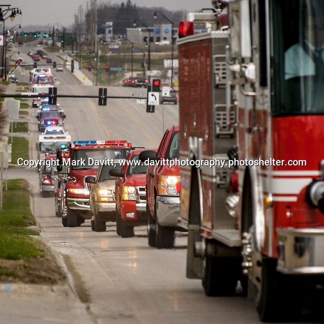 The procession escorting former Indianola Fire Chief Brian Seymour arrives in Indianola. A celebration of life for Seymour was held Saturday at Lutheran  Church of Hope. Seymour was honored with a variety of firefighter traditions, including the striking of four fives, bagpipes and a procession of emergency vehicles escorting him from West Des Moines to his home fire station in Indianola.