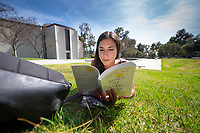 Parker Jay-Pachirat '21 reads a book near Gilman Fountain at the start of Reading Days, May 1, 2019.<br />