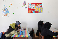 January 13, 2015 - Puchong, Kuala Lumpur (Malaysia). Young female daughters of Ikhwan members attend the Sekolah Menengah Islam Global Ikhwan school in Puchong, to study arabics, read the Koran and following practical workshops learning how to cook, clean or take care of babies. © Thomas Cristofoletti / Ruom