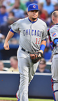Chicago Cubs catcher Kyle Schwarber (12) between innings during a game against the Atlanta Braves on July 18, 2015 in Atlanta, Georgia. The Cubs defeated the Braves 4-0. (Tony Farlow/Four Seam Images)