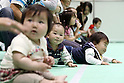 May 8, 2010 - Tokyo, Japan - Babies wait to start a 10 meters crawling competition called 'Babylympic' during the Maternity & Baby Festa 2010 show at Tokyo Big Sight, Japan, on May 8, 2010. Nearly 20,000 people are expected to attend the two-days annual event which features this season's maternity fashions, kids gear, pregnancy information sessions, maternity and exercise workshops for new mothers.