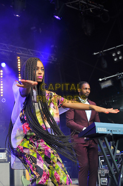 Solange (Solange Knowles) <br /> performing at Glastonbury Festival, Worthy Farm, Pilton, Somerset, <br /> England, UK, 28th June 2013.<br /> half length music gig concert gig live on stage singing long hair braids hands arms funny dancing pink yellow white print catsuit jumpsuit top trousers matching side <br /> CAP/MAR<br /> &copy; Martin Harris/Capital Pictures