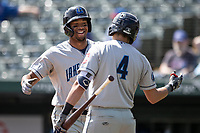 Lake County Captains outfielder Will Benson (29) is greeted at the plate by teammate Ruben Cardenas (4) after hitting a home run against the South Bend Cubs on May 30, 2019 at Four Winds Field in South Bend, Indiana. The Captains defeated the Cubs 5-1.  (Andrew Woolley/Four Seam Images)