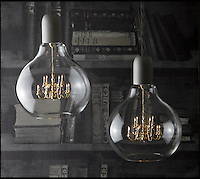 BNPS.co.uk (01202 558833)<br /> Pic: BNPS<br /> <br /> A British company is hoping to become a shining light in the design world - after launching the world's smallest chandelier.<br /> <br /> The minuscule brass candelabra is just three inches wide and two inches tall with tiddly quarter-inch candles - and the whole thing fits inside a lightbulb.<br /> <br /> But despite its dinky size, the luxury decor comes with a whopping price tag - the King Edison pendant lamp will set buyers back an eye-watering &pound;480.