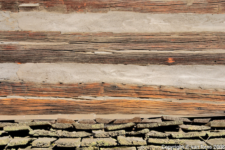 Log cabin detail from building circa 1855. Renovation is preserving the building which features rich weathered hand hewn logs.