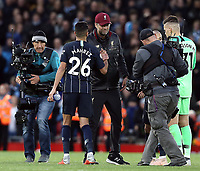Liverpool manager Jurgen Klopp greets Manchester City's Riyad Mahrez at the final whistle<br /> <br /> Photographer Rich Linley/CameraSport<br /> <br /> The Premier League - Liverpool v Manchester City - Sunday 7th October 2018 - Anfield - Liverpool<br /> <br /> World Copyright &copy; 2018 CameraSport. All rights reserved. 43 Linden Ave. Countesthorpe. Leicester. England. LE8 5PG - Tel: +44 (0) 116 277 4147 - admin@camerasport.com - www.camerasport.com