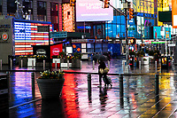 NEW YORK, NY - April 13:  A woman walks around an empty Times Square during a rainy day on April 13, 2020. in New York, United States. The global economy is facing the worst collapse since the WWII, while COVID-19  pandemic has now killed more than 22,000 people in the United States and at least 1,864,629 people died world wide. (Photo by Eduardo MunozAlvarez/VIEWpress)