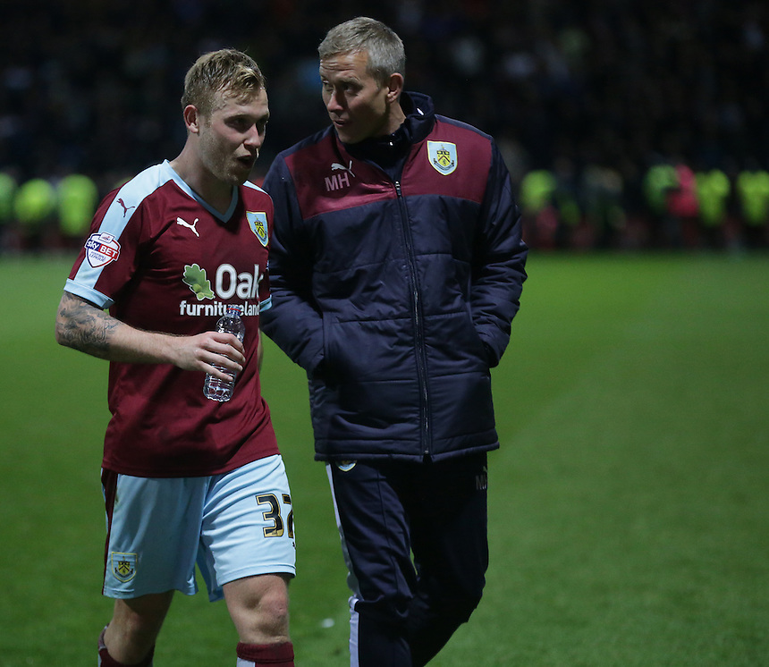 Burnley's Scott Arfield walks off the pitch with Head of Sports Science, Mark Howard <br /> <br /> Photographer Stephen White/CameraSport<br /> <br /> Football - The Football League Sky Bet Championship - Preston North End v Burnley - Friday 22nd April 2016 - Deepdale - Preston <br /> <br /> &copy; CameraSport - 43 Linden Ave. Countesthorpe. Leicester. England. LE8 5PG - Tel: +44 (0) 116 277 4147 - admin@camerasport.com - www.camerasport.com