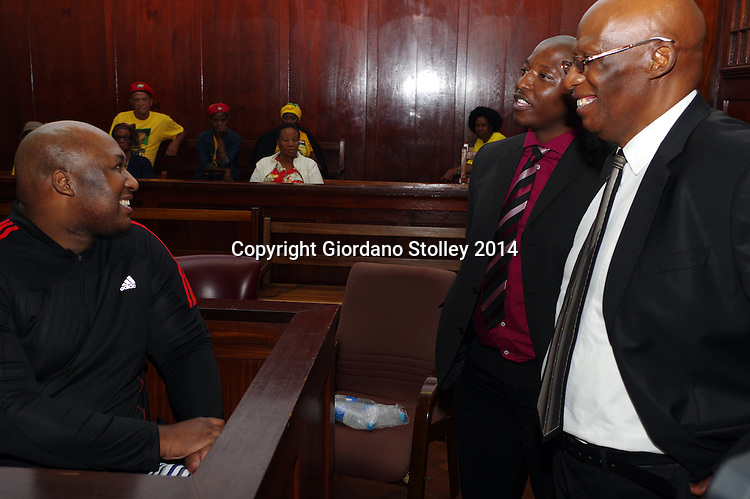 DURBAN - 15 December - Former Blue Bulls rugby player Phindile Joseph Ntshongwana (left) chats with friend and fellow rugby player Kagiso Thema (center) and his father Liston Ntshongwana (right) before being sentenced in the Durban High Court for killing four people with an axe as well as kidnapping and raping a woman. Picture: Allied Picture Press/APP