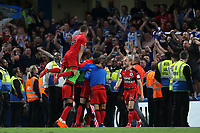Huddersfield Town players celebrate in front of their fans at the final whistle during Chelsea vs Huddersfield Town, Premier League Football at Stamford Bridge on 9th May 2018
