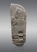 Picture & image of Hittite monumental relief sculpted orthostat stone panel of a Procession Basalt, Karkamıs, (Kargamıs), Carchemish (Karkemish), 900 - 700 B.C. Anatolian Civilisations Museum, Ankara, Turkey.<br /> <br /> Goddess Kubaba. End of pannels. The godess is saeted on a chair which is on a lion. she hold a mirror in her right hand and a pomegranate in her left.<br /> <br /> Against a gray background.