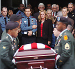 University of Mississippi police chief Jeff Van Slyke (center) escorts Lisa Langley during the funeral for her husband, police officer Robert Langley, in Oxford, Miss. Wednesday, October 25, 2006. Officer Langley was killed early Saturday, October 21, 2006, while conducting a traffic stop.