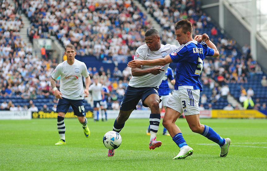 Preston North End's Chris Humphrey vies for possession with Ipswich Town's Jonas Knudsen<br /> <br /> Photographer Chris Vaughan/CameraSport<br /> <br /> Football - The Football League Sky Bet Championship - Preston North End v Ipswich Town - Saturday 22nd August 2015 - Deepdale - Preston<br /> <br /> &copy; CameraSport - 43 Linden Ave. Countesthorpe. Leicester. England. LE8 5PG - Tel: +44 (0) 116 277 4147 - admin@camerasport.com - www.camerasport.com