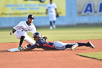 Asheville Tourists second baseman Carlos Herrera (4) fields and attempts to tag a hard sliding Ronald Acuna (24) during a game against the Rome Braves at McCormick Field on April 14, 2016 in Asheville, North Carolina. The Braves defeated the Tourists 4-3. (Tony Farlow/Four Seam Images)