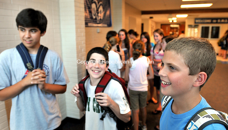 SOUTHBURY, CT, 08 JUNE 2011-060811JS03--Jared Gustenhoven, right, 13, a student at Rochambeau Middle School in Southbury, talks about The Sandwich Club, as fellow students Griffin Namin, 13, left and Max Shapiro, 14, center, look on. The club is a group of students that have make over 3000 sandwiches this year for the Greater Waterbury Interfaith Ministries as part of a charity project. <br /> Jim Shannon/Republican-American