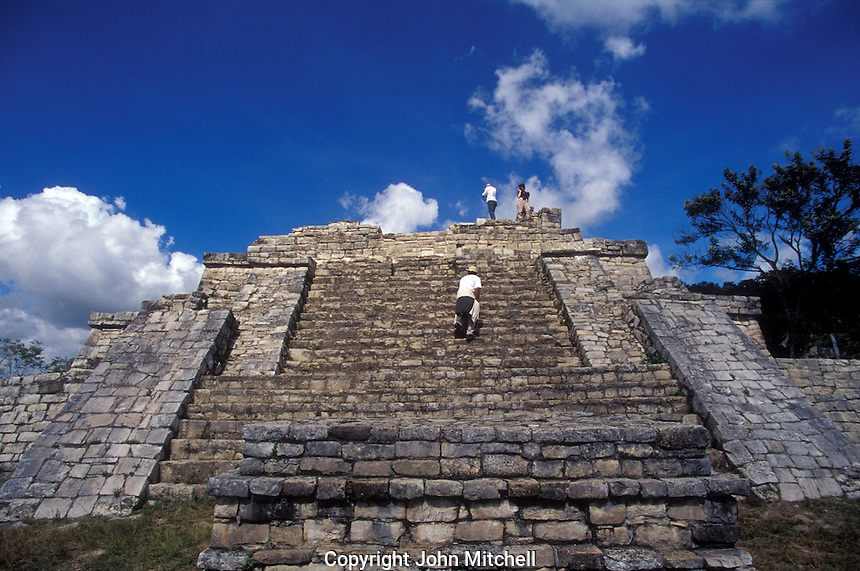 Tourists scaling the Acroplois, the main structure at at the Mayan ruins of Chinkultic near Comitan, Chiapas, Mexico