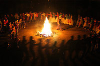 Walabi residents and visiting relatives encircle a bonfire, singing traditional songs and dancing in celebration of the Lunar New Year. As electricity is sparse and often unavailable, fire remains the village's main source for light and the only source for heat.