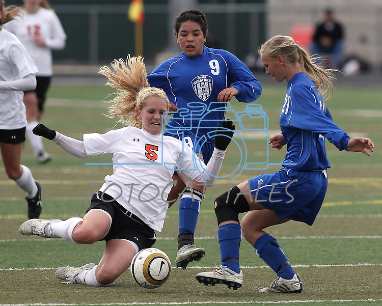 Douglas' Cora Moody slides for the ball against Carson's Alissa Hayes during the girls soccer zone championship at Damonte Ranch High School in Reno, Nev. on Saturday, Nov. 5, 2011 . Carson won 2-1..Photo by Cathleen Allison.