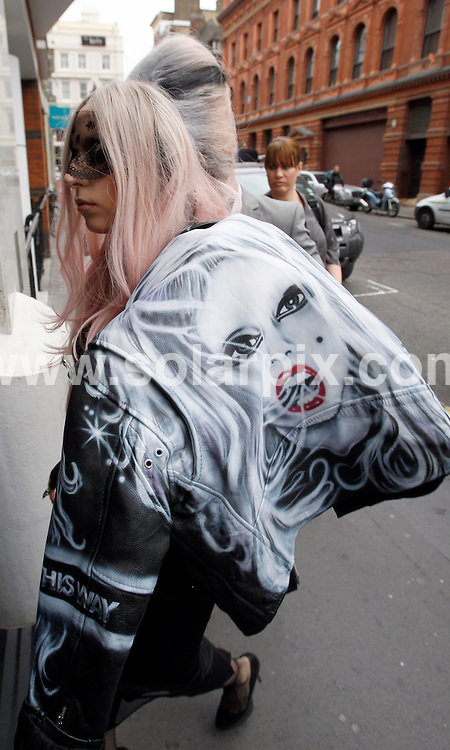 **ALL ROUND PICTURES FROM SOLARPIX.COM**                                             **NO UK NEWSPAPER PUBLICATION**.**UK MAGAZINE & SUPPLEMENT PUBLICATION ONLY** AND NO PUBLICATION IN AUSTRALIA, BELGIUM, FRANCE, GERMANY, ITALY, SCANDINAVIA AND USA**                                                                                  Caption: Lady Gaga leaves an office building in Covent Garden this afternoon wearing a necklace made from My Little Pony heads. The US singer was in London to be the guest editor of the International Metro newspaper as part of the promotional campaign for her latest album. London, UK. 16 May 2011                                                                              This pic: Lady Gaga                                                                                             JOB REF: 13352 SFE       DATE: 16_05_2011                                                           **MUST CREDIT SOLARPIX.COM OR DOUBLE FEE WILL BE CHARGED**                                                                      **MUST AGREE FEE BEFORE ONLINE USAGE**                               **CALL US ON: +34 952 811 768 or LOW RATE FROM UK 0844 617 7637**