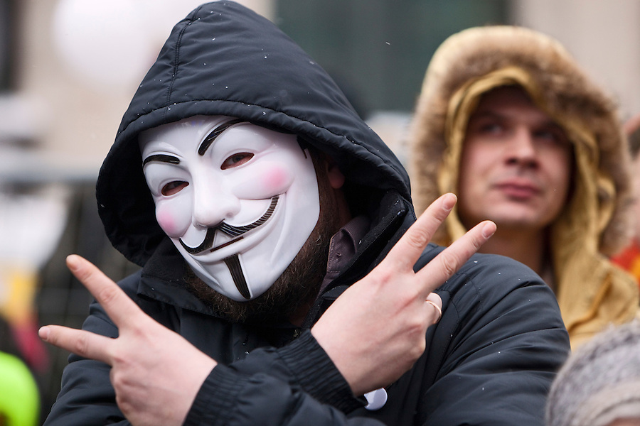 """Moscow, Russia, 24/12/2011..A protester wearing a """"V For Vendetta"""" mask as an estimated crowd of up to 100,000 gather for a protest against election fraud and Prime Minister Vladimir Putin in the largest anti-government demonstration in Russia since the collapse of the Soviet Union."""