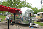 Silver 1953 Airstream Flying Cloud vintage travel trailer.