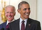 United States President Barack Obama, joined by US Vice President Joe Biden, share a laugh as Obama delivers remarks at the Easter Prayer Breakfast at the White House in Washington, D.C. on March 30, 2016. <br /> Credit: Kevin Dietsch / Pool via CNP