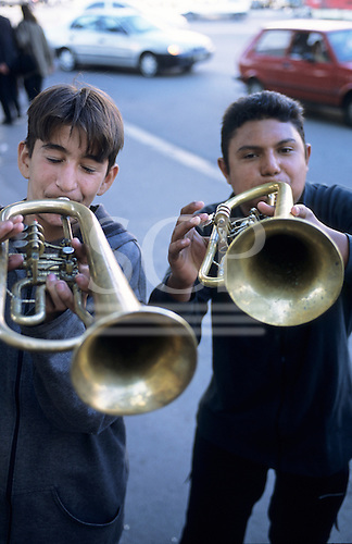 Belgrade, Serbia, Yugoslavia. Two young buskers playing trumpets on the street.