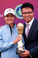 HAIKOU, CHINA - OCTOBER 31:  Lorena Ochoa (L) of Mexico poses with Dr. Ken Chu, Vice Chairman of Mission Hills Group after winning the Mission Hills Start Trophy at Mission Hills Resort on October 31, 2010 in Haikou, China.  The Mission Hills Star Trophy is Asia's leading leisure liflestyle event and features Hollywood celebrities and international golf stars. Photo by Victor Fraile / studioEAST