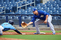 Dunedin Blue Jays first baseman Rowdy Tellez (8) stretches for a throw as Granden Goetzman (6) dives back to the bag during a game against the Charlotte Stone Crabs on July 26, 2015 at Charlotte Sports Park in Port Charlotte, Florida.  Charlotte defeated Dunedin 2-1 in ten innings.  (Mike Janes/Four Seam Images)