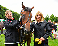Stable staff with Red Dragon in the winners enclosure during Afternoon Racing at Salisbury Racecourse on 7th August 2017