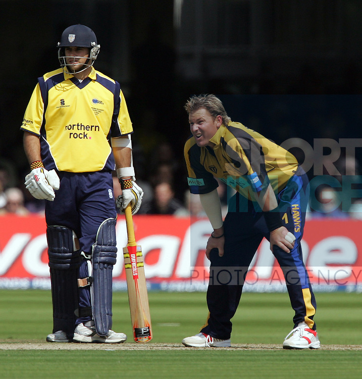 Hampshire's Shane Warne is left with his hands on his knees. .Pic: SPORTIMAGE/David Klein